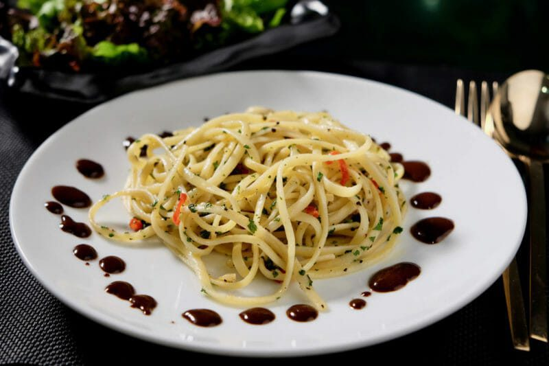 Garlic and anchovy pasta. Black garlic and balsamic drizzle. Inspired by the flavors of the Mediterranean Main Course Seafood
