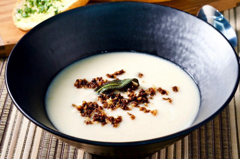 Roasted fennel, cauliflower, and cannellini bean soup. Black garlic crumbs Featured-Vegetarian Inspired by the flavors of the Mediterranean Lunch Main Course Soup Vegetarian